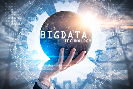 The double exposure image of the businessman hold the big data hologram on hand