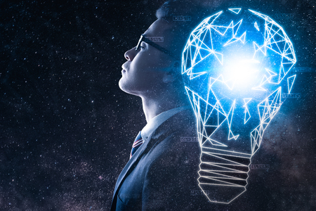 The double exposure image of the businessman thinking overlay with milky way galaxy and illumination lamp image. the concept of imagination, technology, future and inspiration.