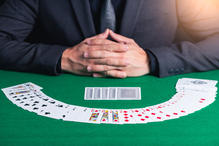 the abstract image of the play cards stack over front of the dealer. the concept of casino, gambling, poker, blackjack and cards. Reklamní fotografie