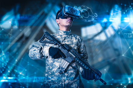 The abstract image of the soldier use a VR glasses for combat simulation training overlay with the hologram. the concept of virtual hologram, simulation, gaming, internet of things and future life.