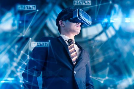 The abstract double exposure image of businessman using a smart glasses or vr glasses overlay with virtual hologram image. the concept of communication, internet of things and future life.
