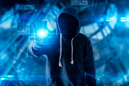The abstract image of the hacker standing overlay with futuristic hologram and the future cityscape is backdrop. the concept of cyber attack, virus, malware, illegally and cyber security. Imagens