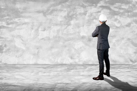 the abstract image of the engineer standing in the white empty room and copy space. tThe concept of engineering, construction, city life and future. Stock Photo