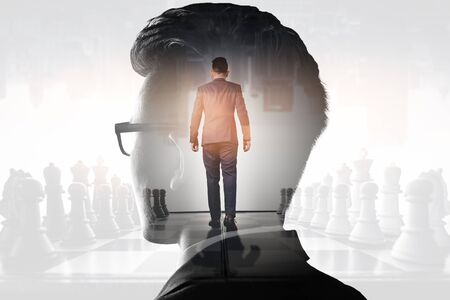 The double exposure image of the businessman thinking overlay with chess game and cityscape image and white copy space. the concept of strategic, planning, management, intelligence and education.