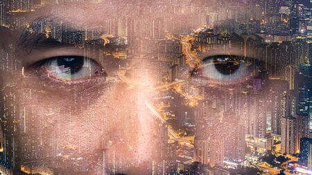 The double exposure image of the businessmans eye overlay with cityscape image. The concept of modern life, futuristic, technology, iris scanner and internet of things. Stock Photo