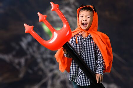 the abstract image of the boy in the Halloween costume. the concept of Halloween, festival, October, and childhood.