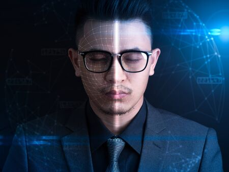 The abstract image of the businessman using a smartphone overlay with futuristic hologram. The concept of modern life, technology, biometrics and internet of things