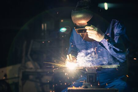 The worker working via the welding method. the concept of welding, machinery, industrial4.0 and manufacturing.