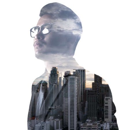 The double exposure image of the businessman seriously thinking during sunrise overlay with cityscape image.