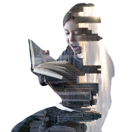 the double exposure image of the girl is reading a book and overlay with the cityscape image. the concept of education, intelligent, children and knowledge.