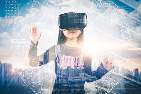 The abstract double exposure image of the girl using smart glasses or VR glasses overlay with virtual hologram image. the concept of communication, internet of things and future life.