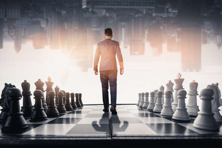 the businessman walking on the chessboard
