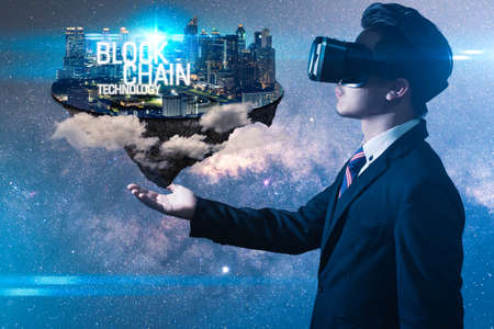 The abstract image of the business man hold the blockchain hologram on hand. the concept of cryptocurrency, blockchain, internet of things and future life