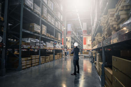 the engineer standing in the warehouse store. the concept of the engineering and construction.