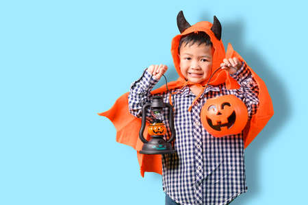 the childrens in the Halloween costume. the concept of Halloween, festival, party and happiness