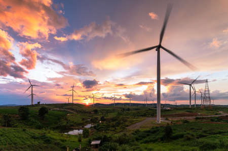 the wild turbines field and the sunrise moments. the concept of environment, electricity, industry and technology