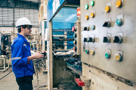 the worker working with automation robot in the factory. the concept of robotics, manufacturing, automotive and industrial Standard-Bild