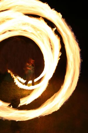 twist: person spinning fire with a twist Stock Photo
