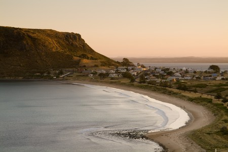 Stanley's main attraction, The Nut, peers over the northwest Tasmanian town at sunset.  Stock Photo - 6949179