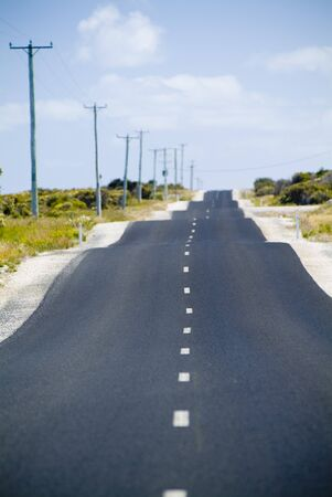 Heat haze rises and the road gets a little bumpy. Stock Photo - 6949185