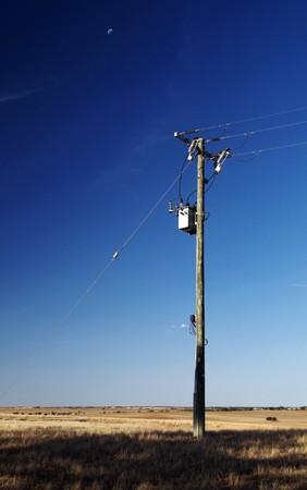 Single power pole on blue sky Stock Photo - 6949190