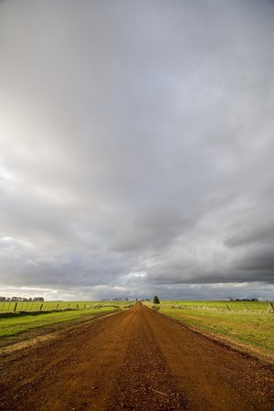 Beautiful light appears amidst winter storms on a deserted country road. photo