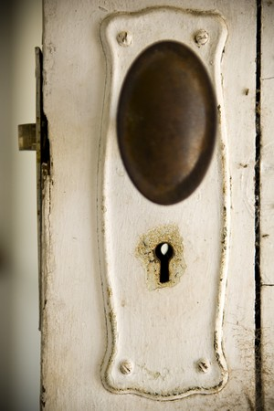 Old fashioned keyhole on a classic timber door. photo