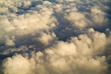 High above the clouds with beautiful golden light photo