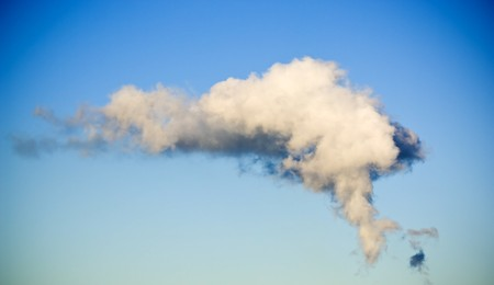 Large clouds formed in the air by a coal-fired power station below photo