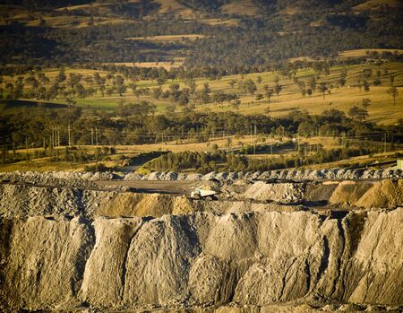 Huge walls of moved earth with roads through it in a large coal mine Stock Photo - 7611850