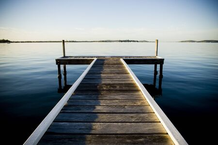 Wooden pier  jetty stretches out into an idyllic ocean