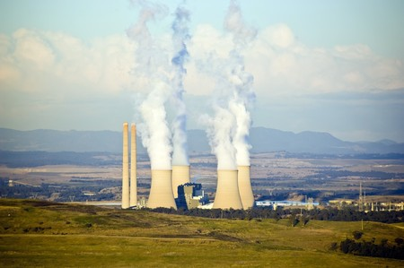 Four massive smoke stacks from a coal fired power station photo