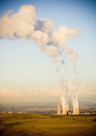 coal fired: Four massive smoke stacks from a coal fired power station Stock Photo