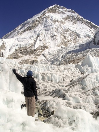 nepal: Hiker stands in the Khumbu Icefield at the basecamp of Mt Everest, Nepal. Stock Photo
