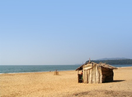 A small hut on a deserted beach on a hot sunny day photo