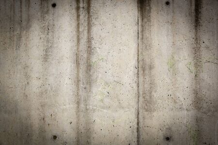 Tall concrete wall in rough, gunge style with stains and wear Stock Photo