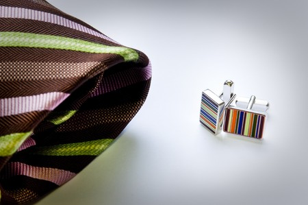 Modern, contemporary business tie and cuff links in fashionable colours photo