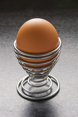 homeware: Eggs in modern spiral metal egg cup on bench top