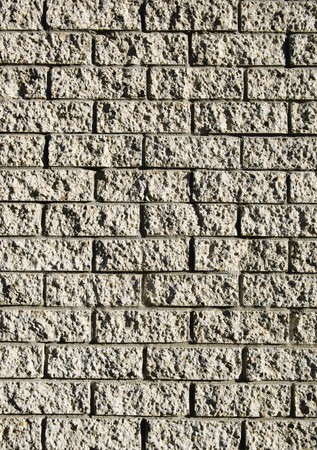 Grunge style brick wall with rough bricks in sunlight Stock Photo - 8024774