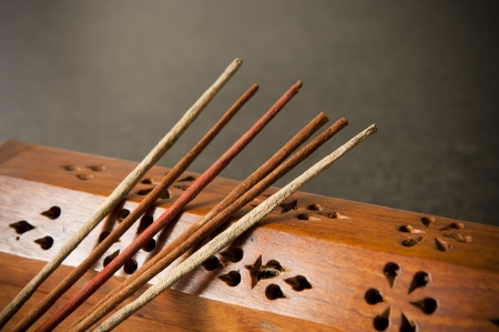incense sticks: Incense sticks against a timber box