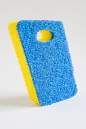 Blue and yellow scrubbing sponge / scourer Stock Photo - 8024756