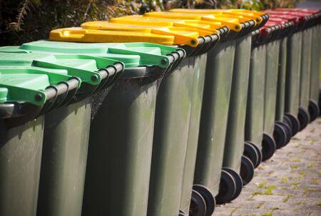 Row of large green wheelie bins for rubbish Stock Photo