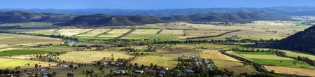 australia farm: Beautiful country area with small town and brightly colored fields