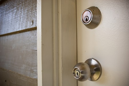 Details of a stainless steel door handle with key lock photo