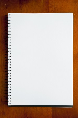 A large spiral bound notebook with blank pages Stock Photo
