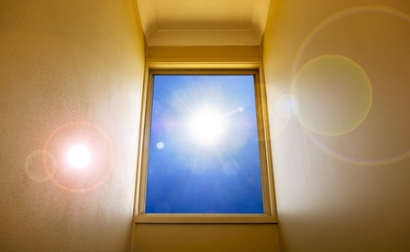 A large clear window leads up to the bright sun photo