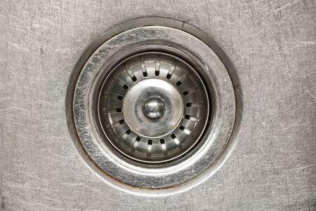 Stainless steel sink plug in a sink with water photo