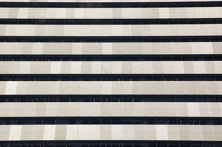 creates: The exterior of an office building creates pattern and texture