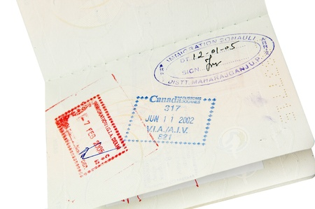 Passport with multiple stamps isolated over white photo