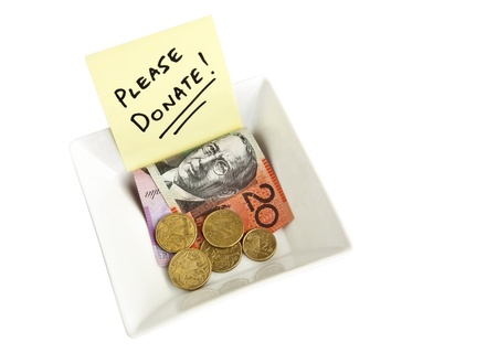 A white bowl with a note asking people to Please Donate Stock Photo - 9321990
